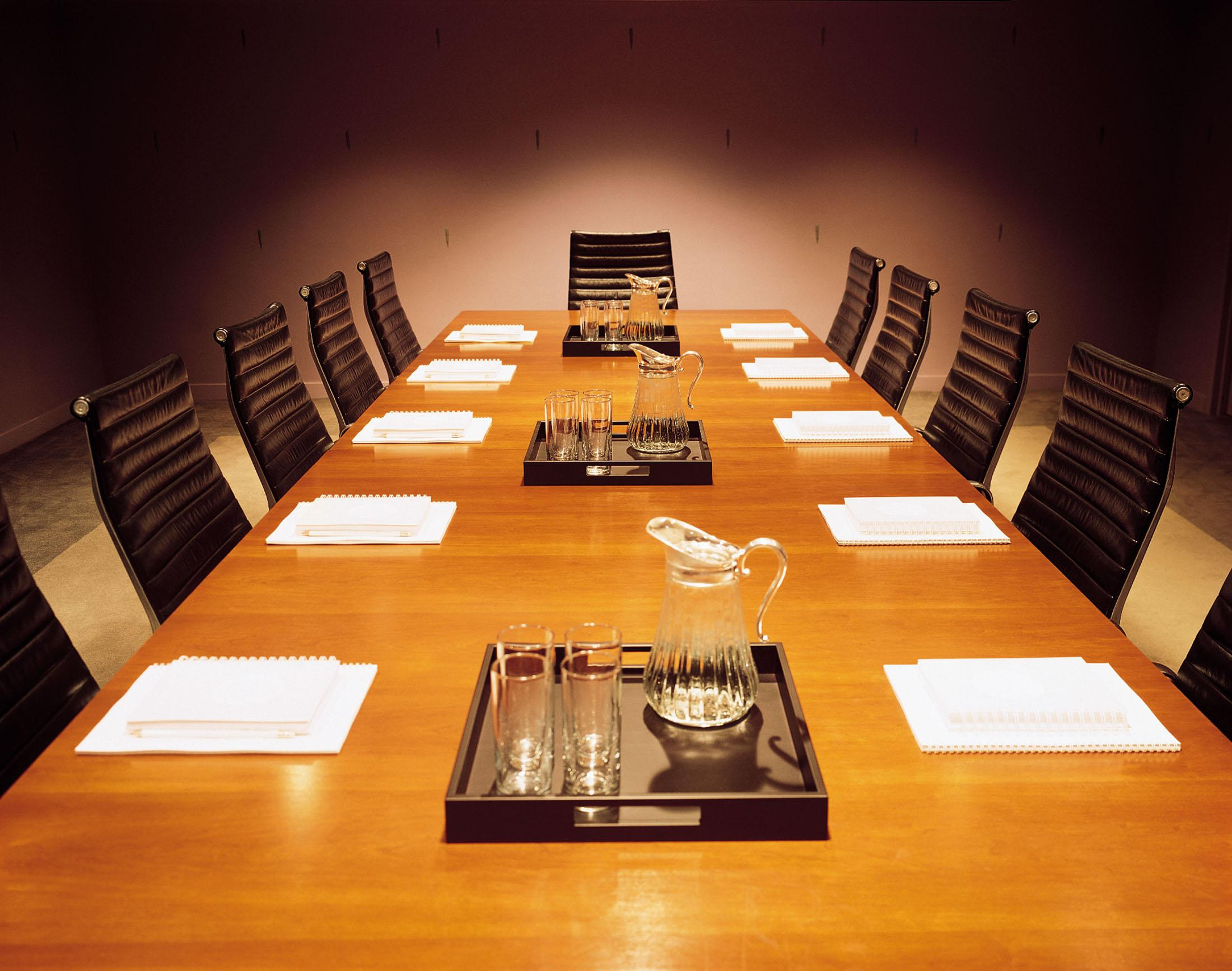 Board room table set for a meeting