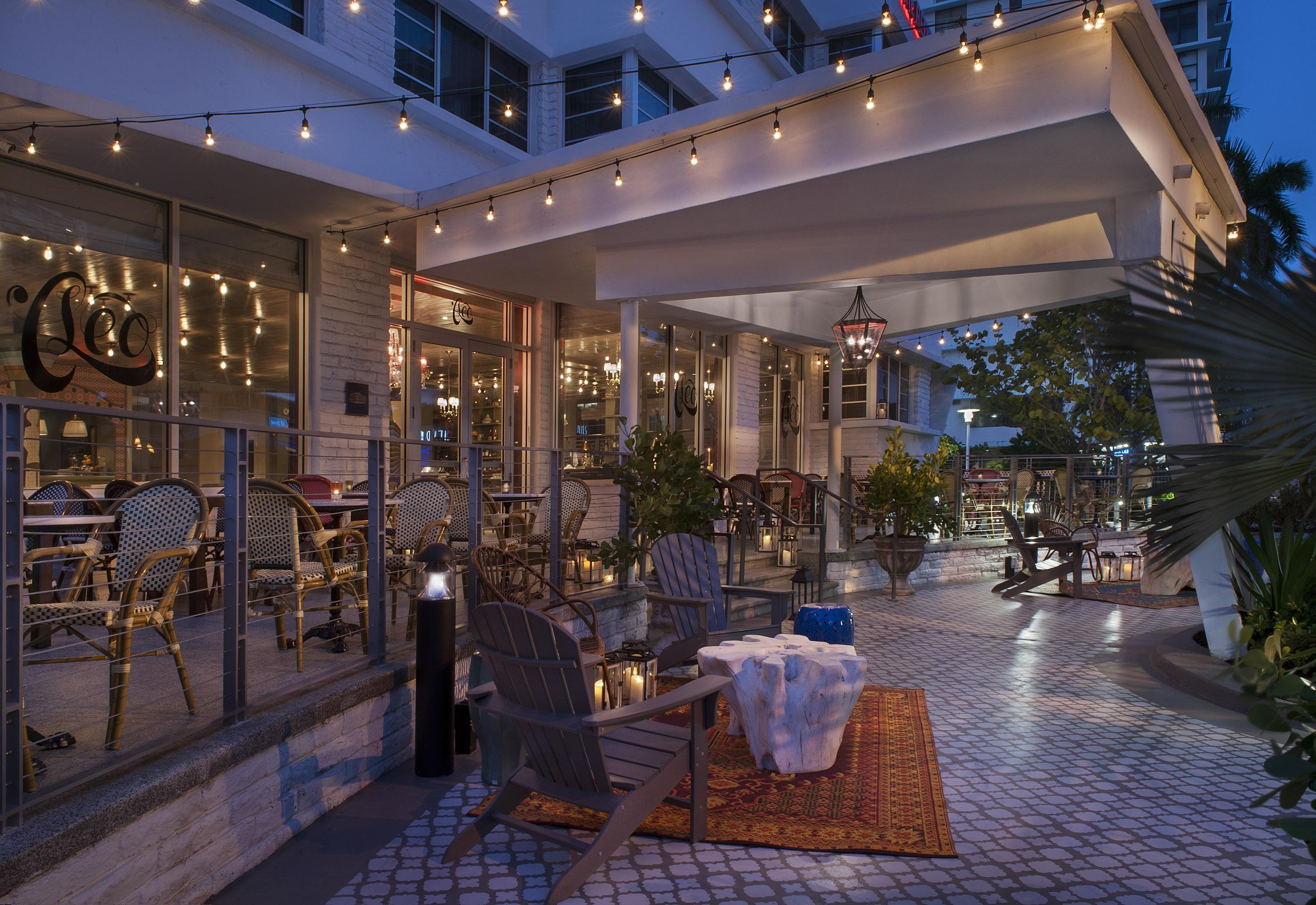 hotel patio with chairs at night