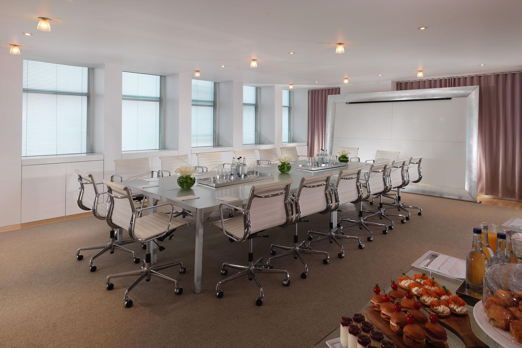 boardroom with white chairs