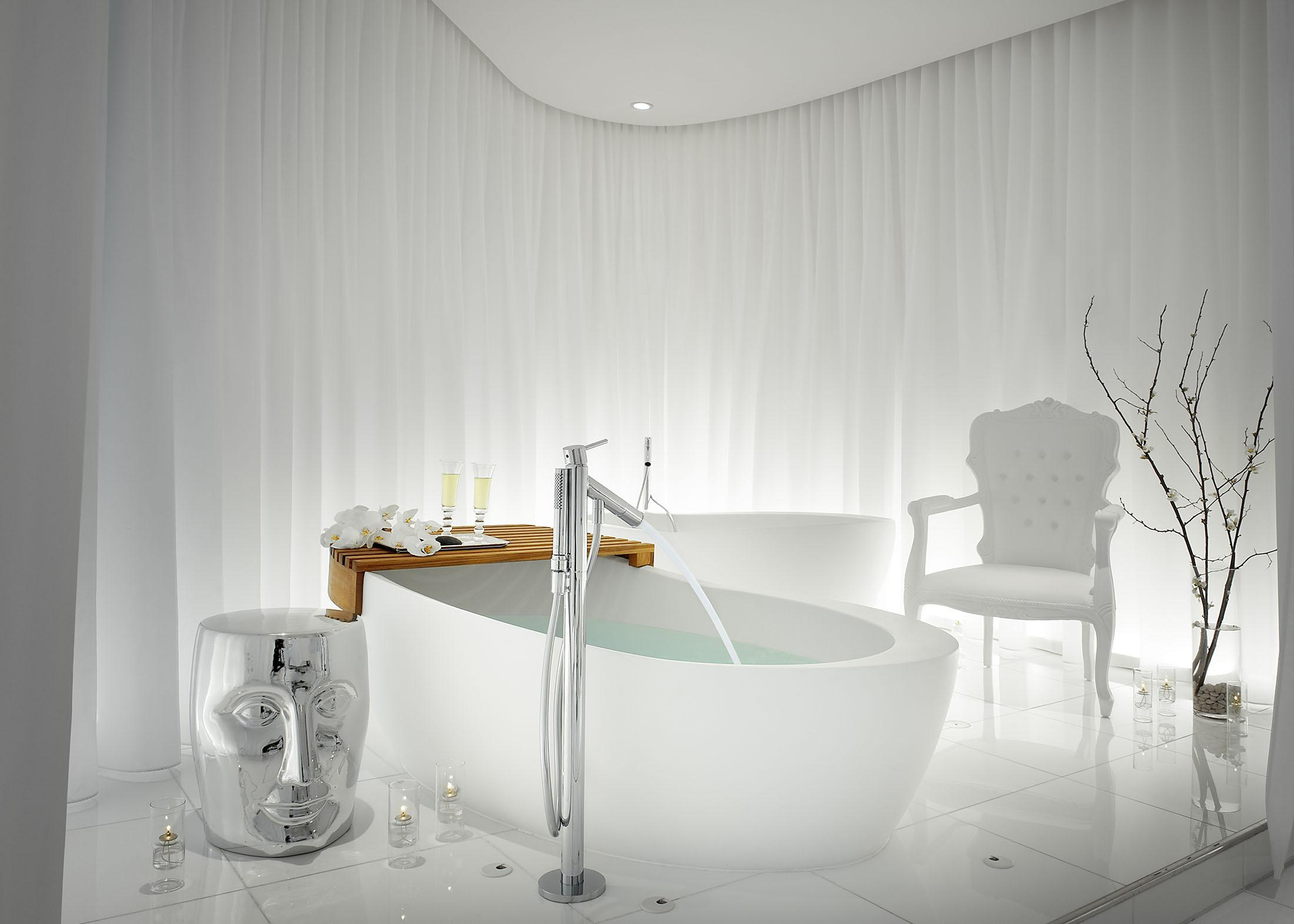 A tub being filled in a serene white spa