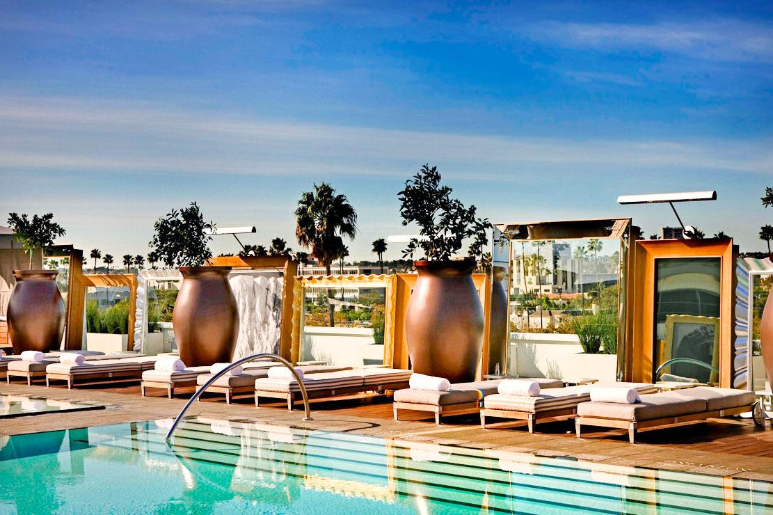 a rooftop pool with cabanas