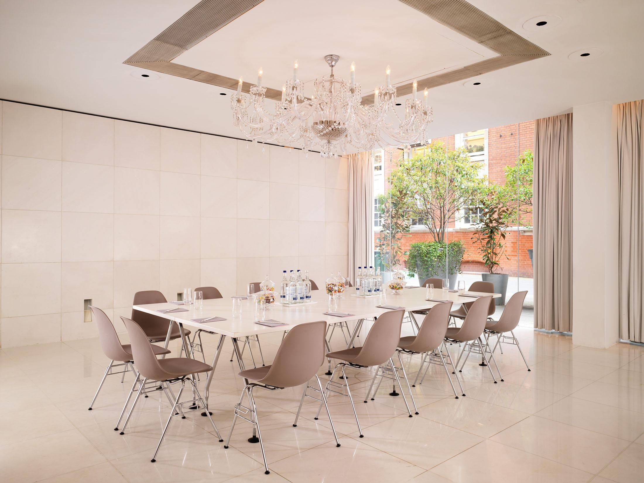 meeting room with large window and boardroom table