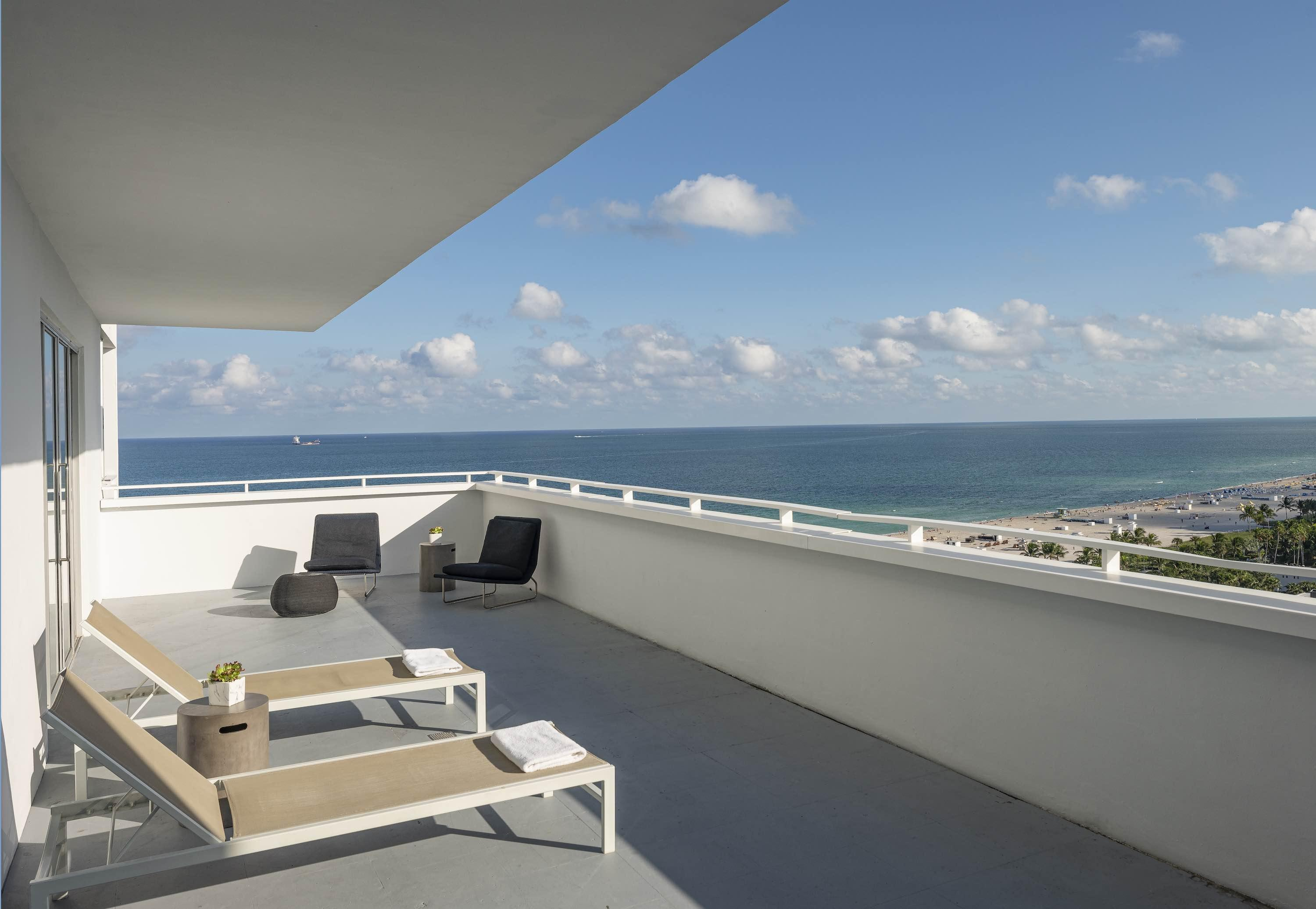 hotel suite balcony overlooking the ocean