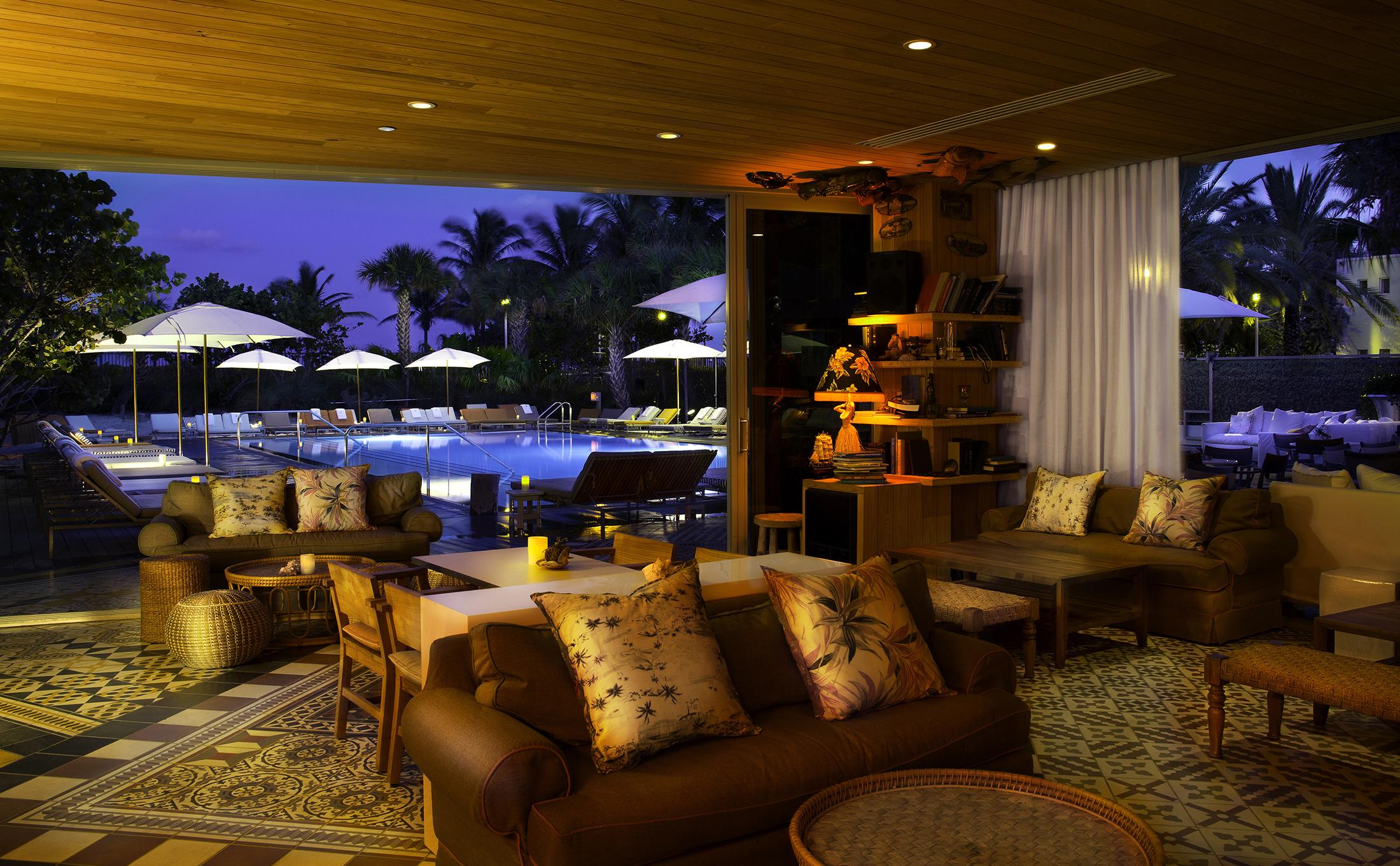 Hyde Beach outdoor pool lounge area at night