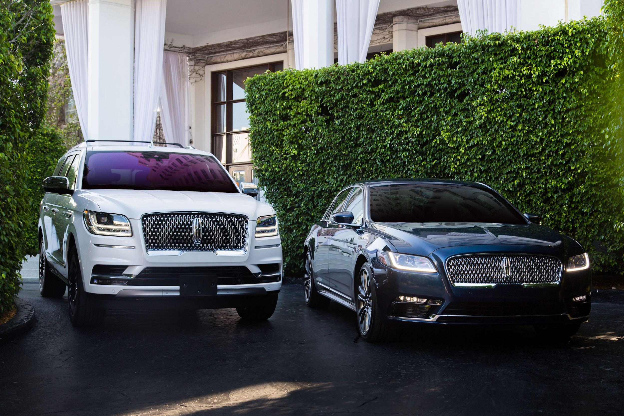 White lincoln navigator and black Lincoln towncar
