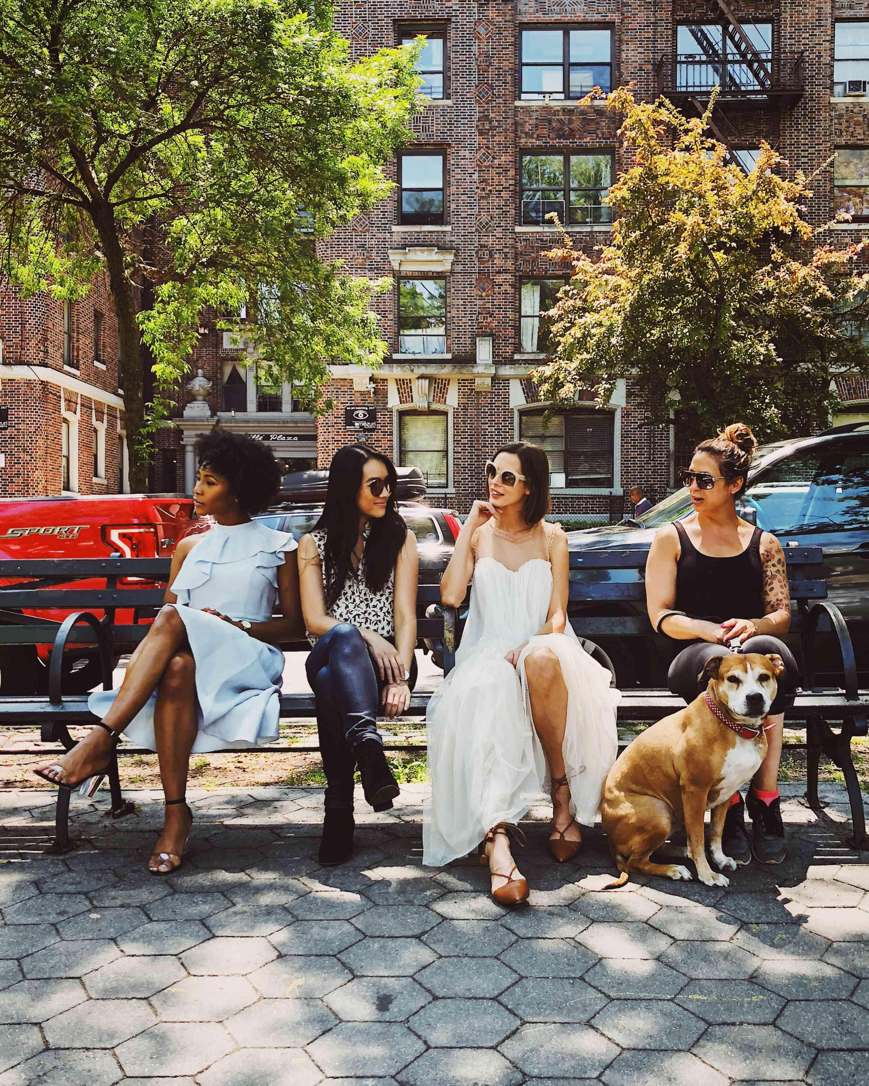 four women on a park bench in new york