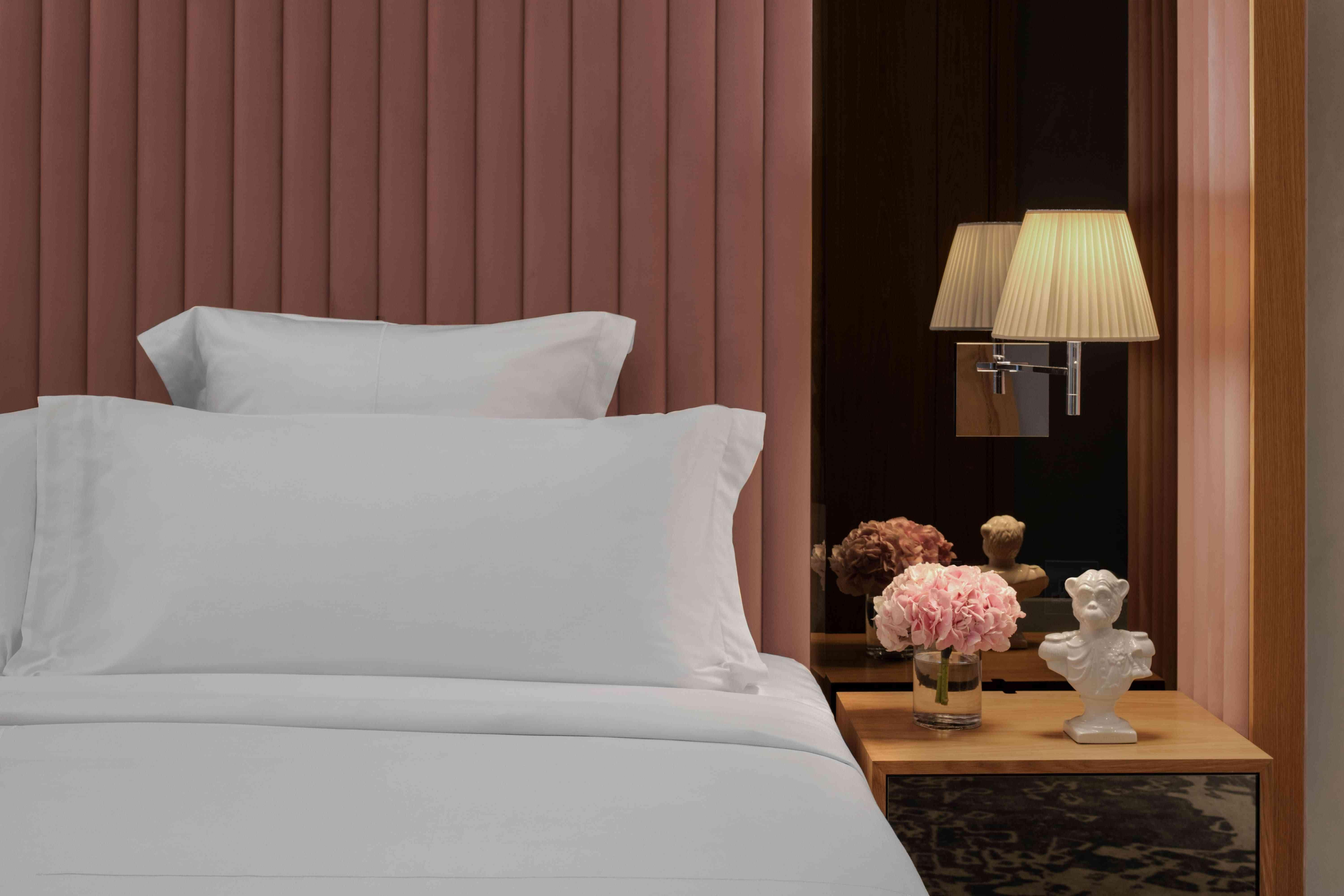 hotel bed and night stand