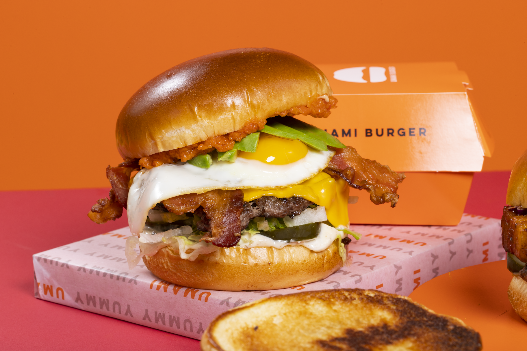 Umami Burger with packaging in the background