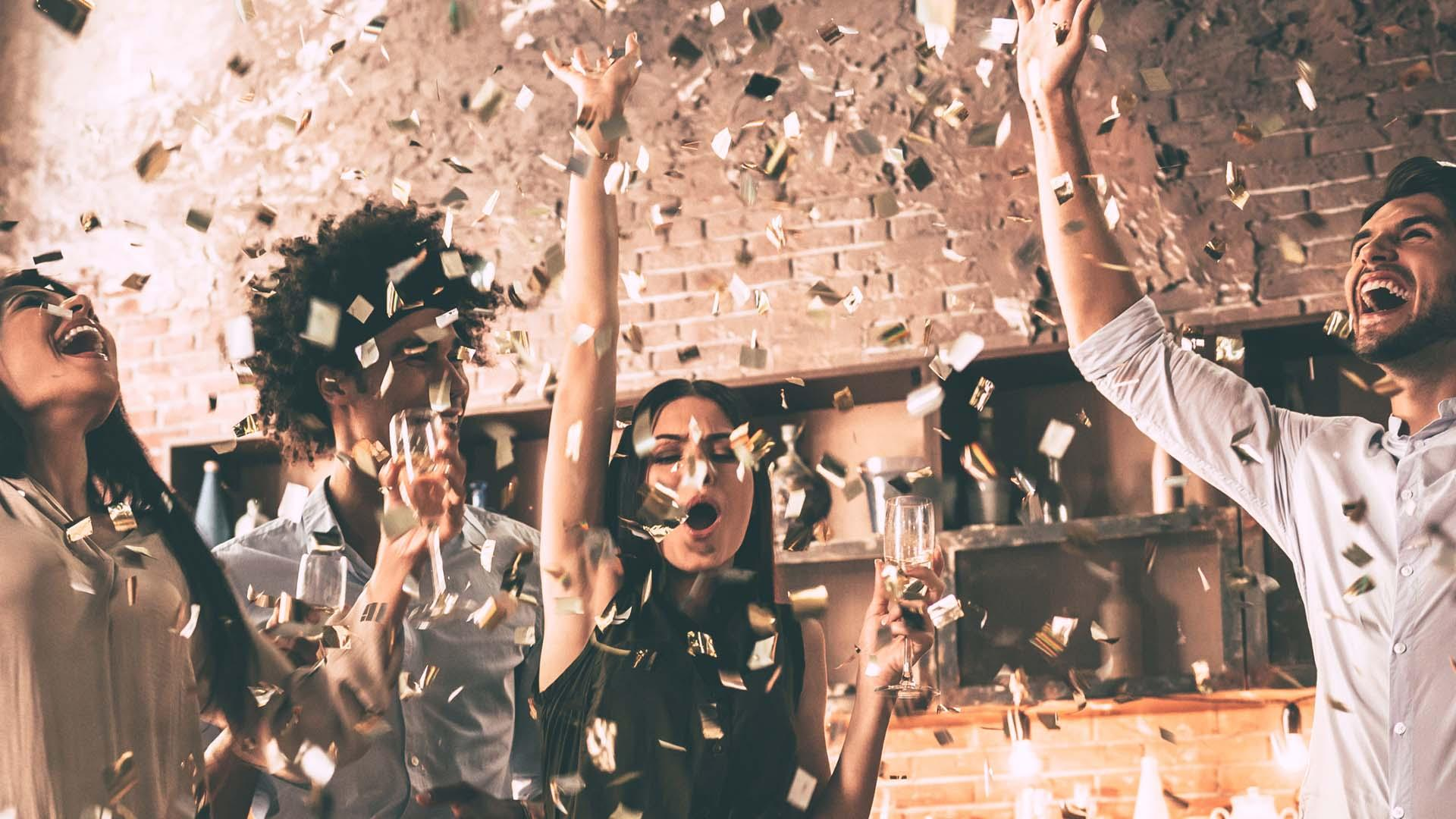 People partying in confetti