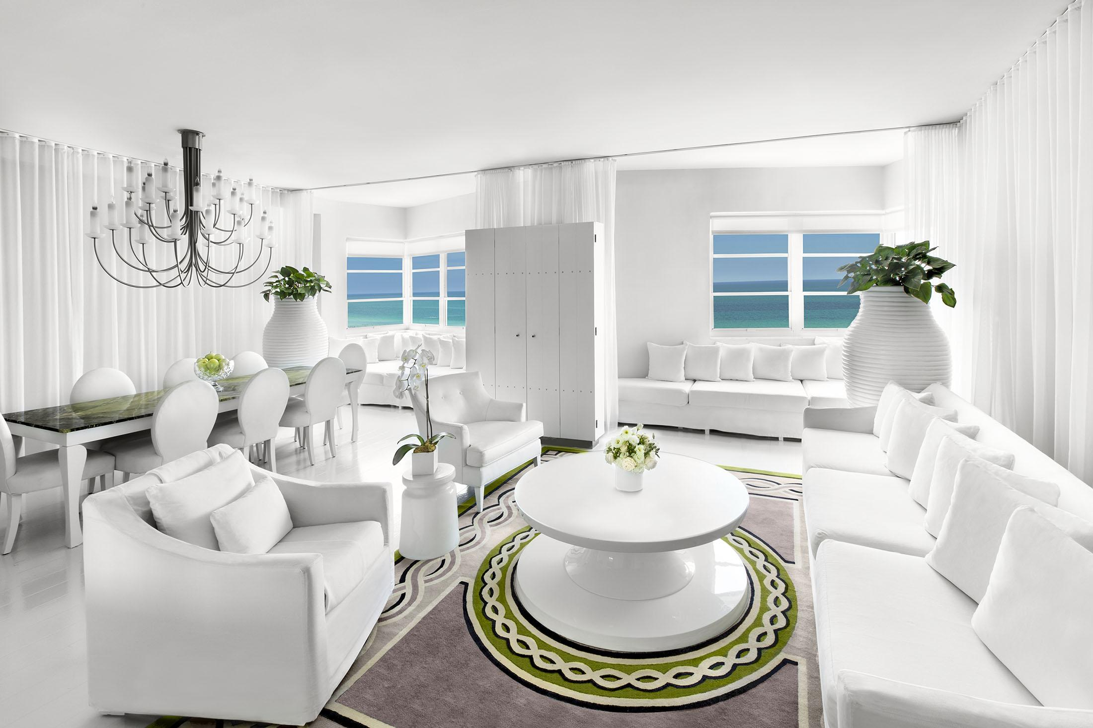 All white living room in Delano apartment