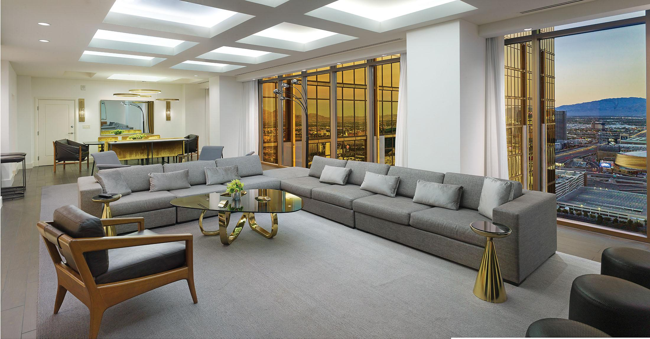 Grey sofas in large living room with view of Las Vegas strip