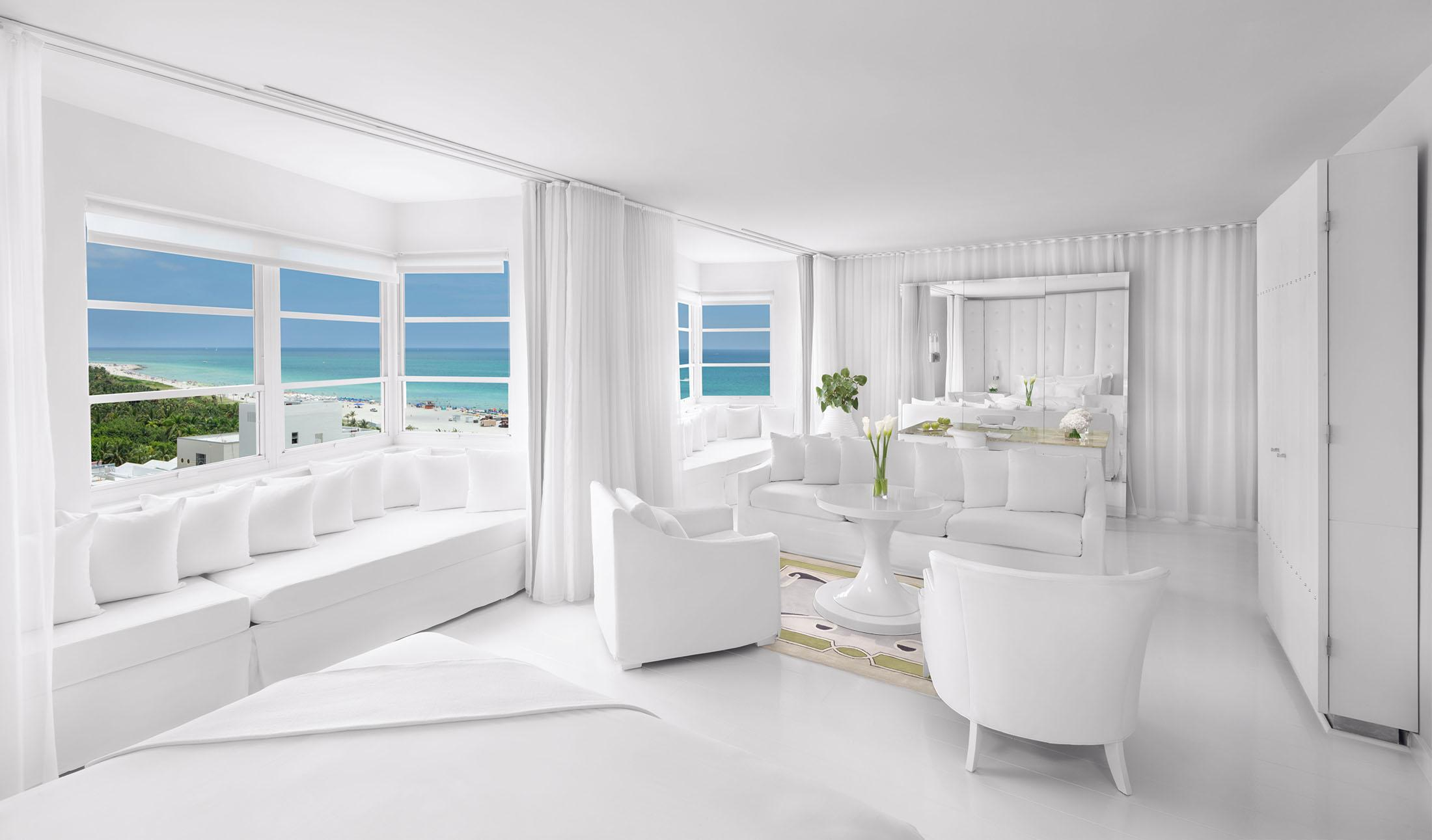 Airy white hotel room with ocean view