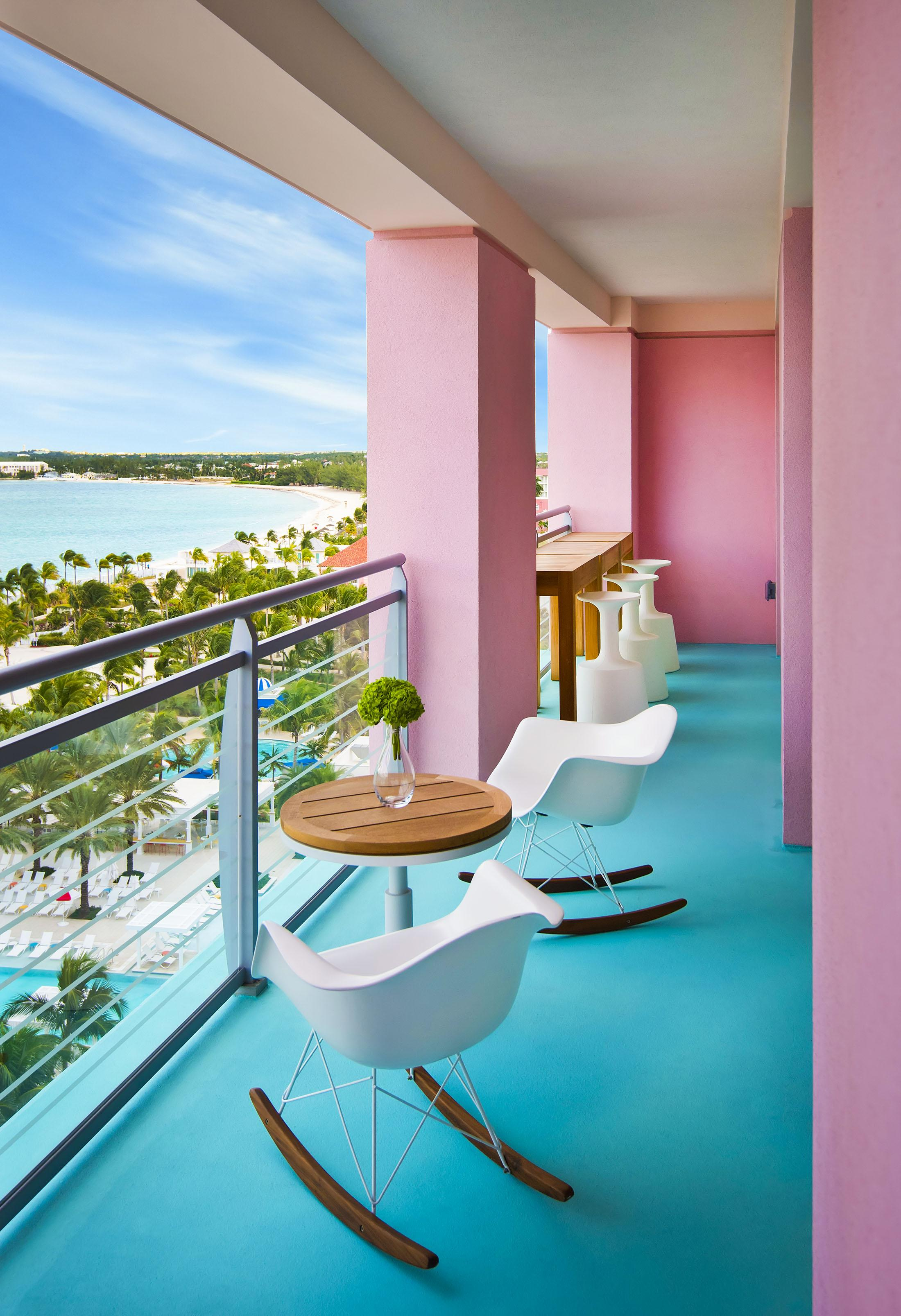 A brightly colored patio overlooking the beach.