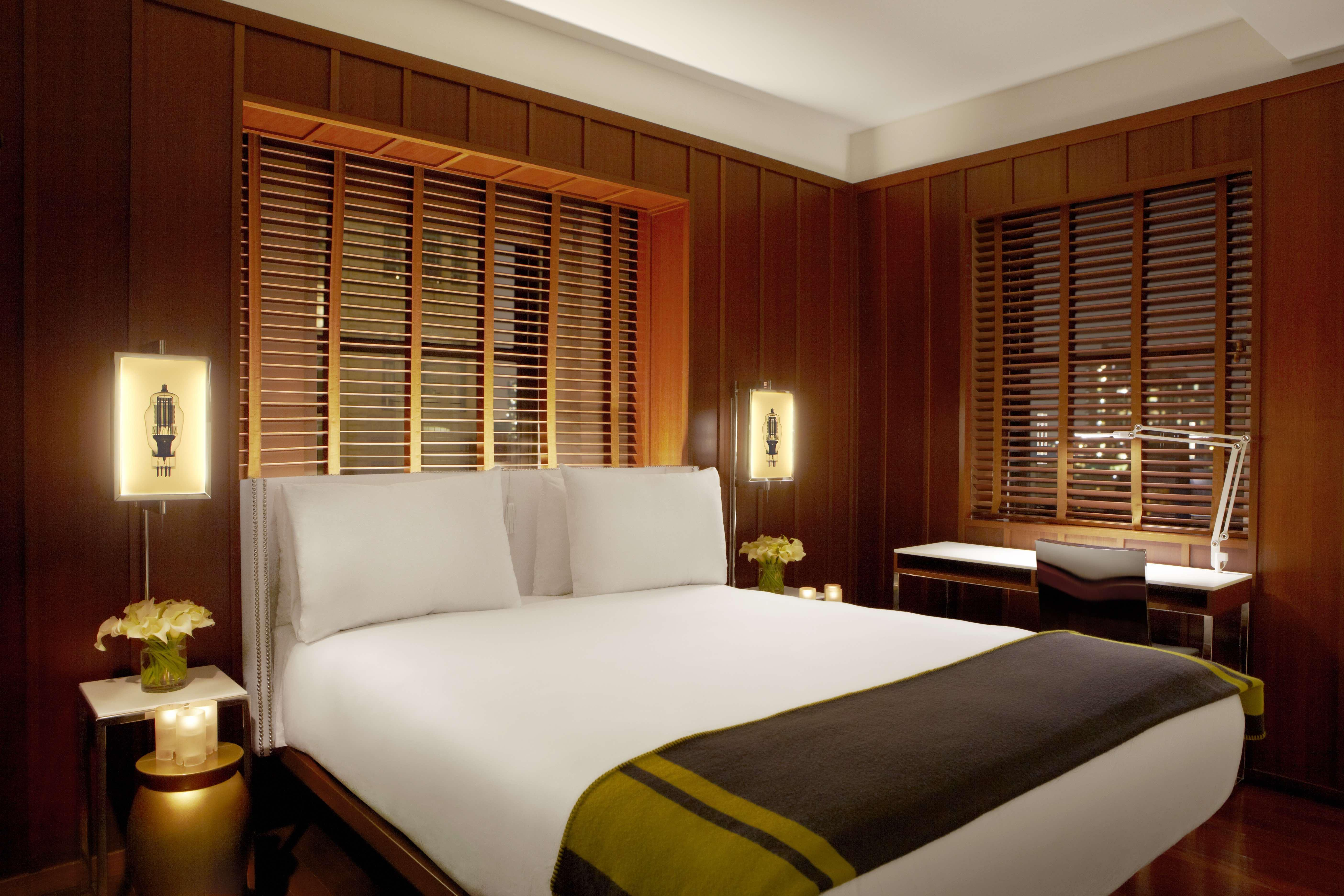 superior hotel room with large bed and dark wood walls