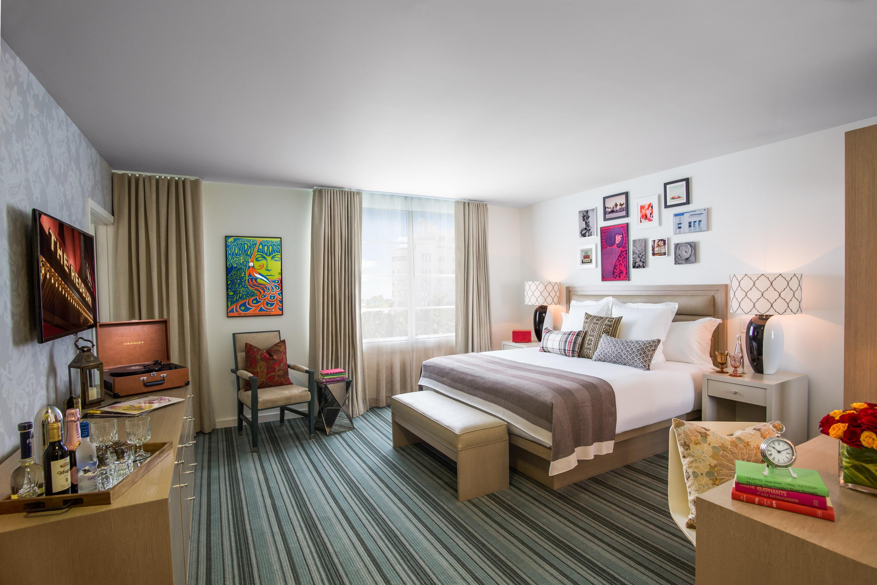 hotel room with king bed and framed art