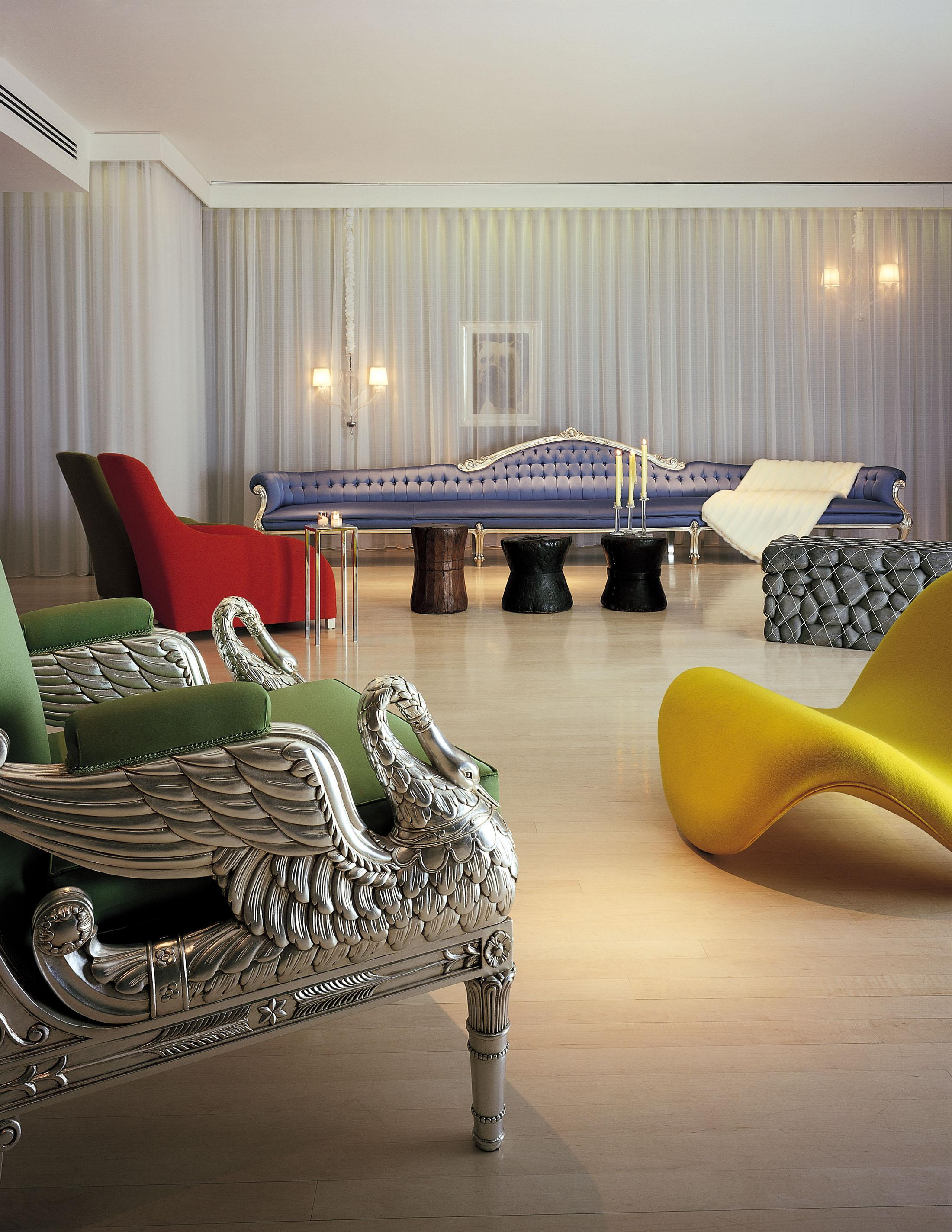 hotel living space with silver chair shaped like a bird