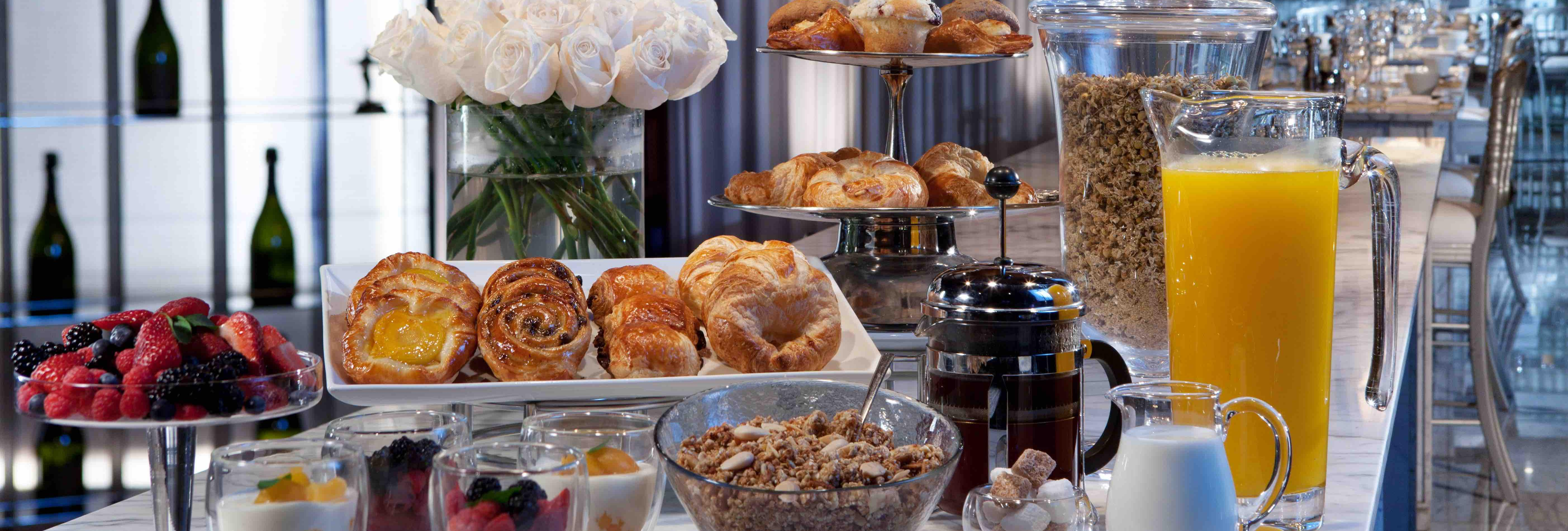 decadent breakfast spread with pastries and juice