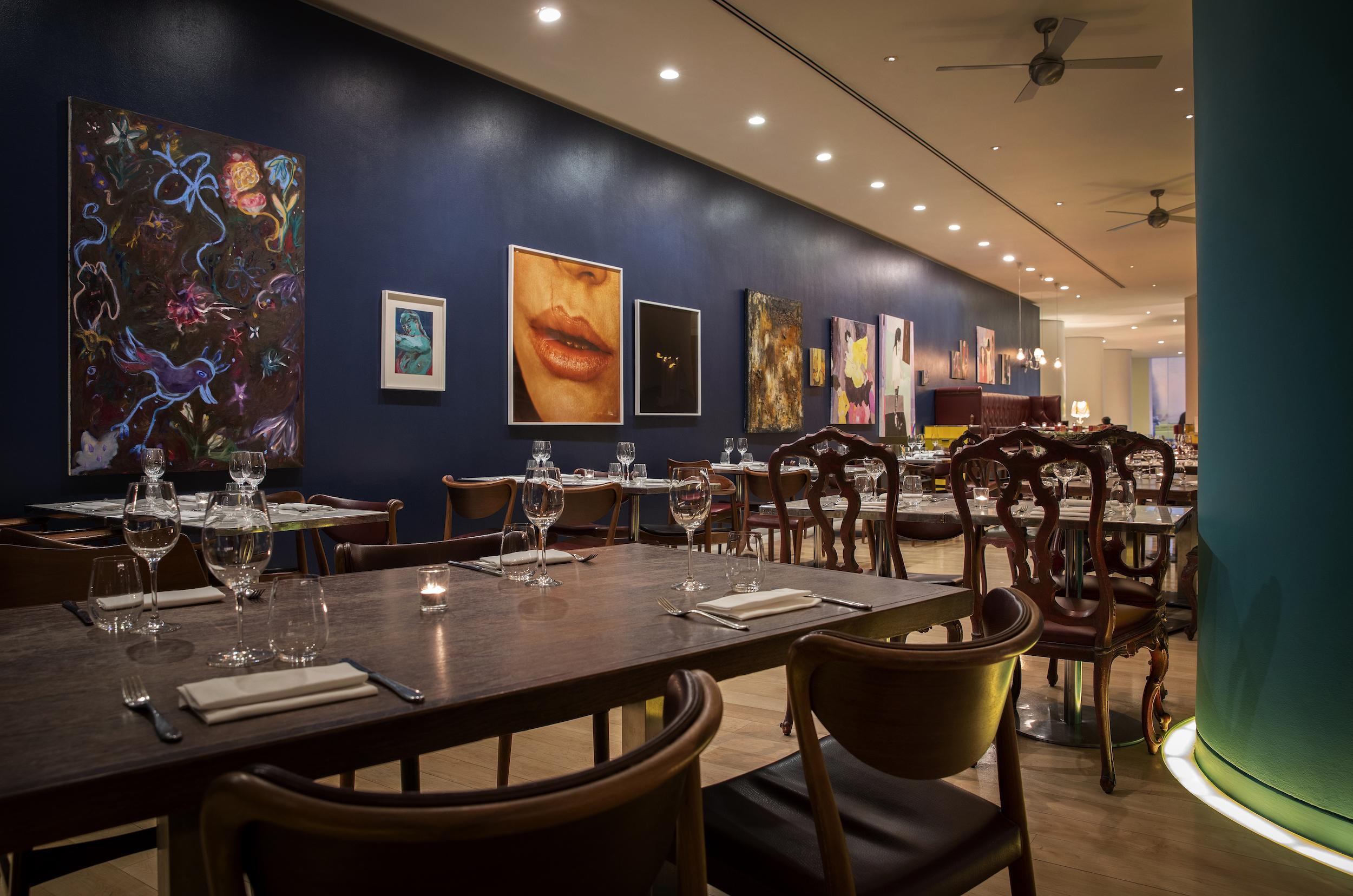 restaurant tables with navy blue wall