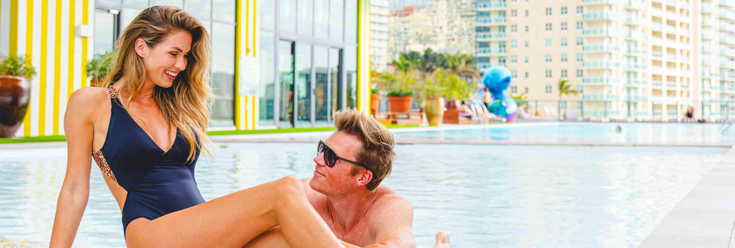 man and woman poolside