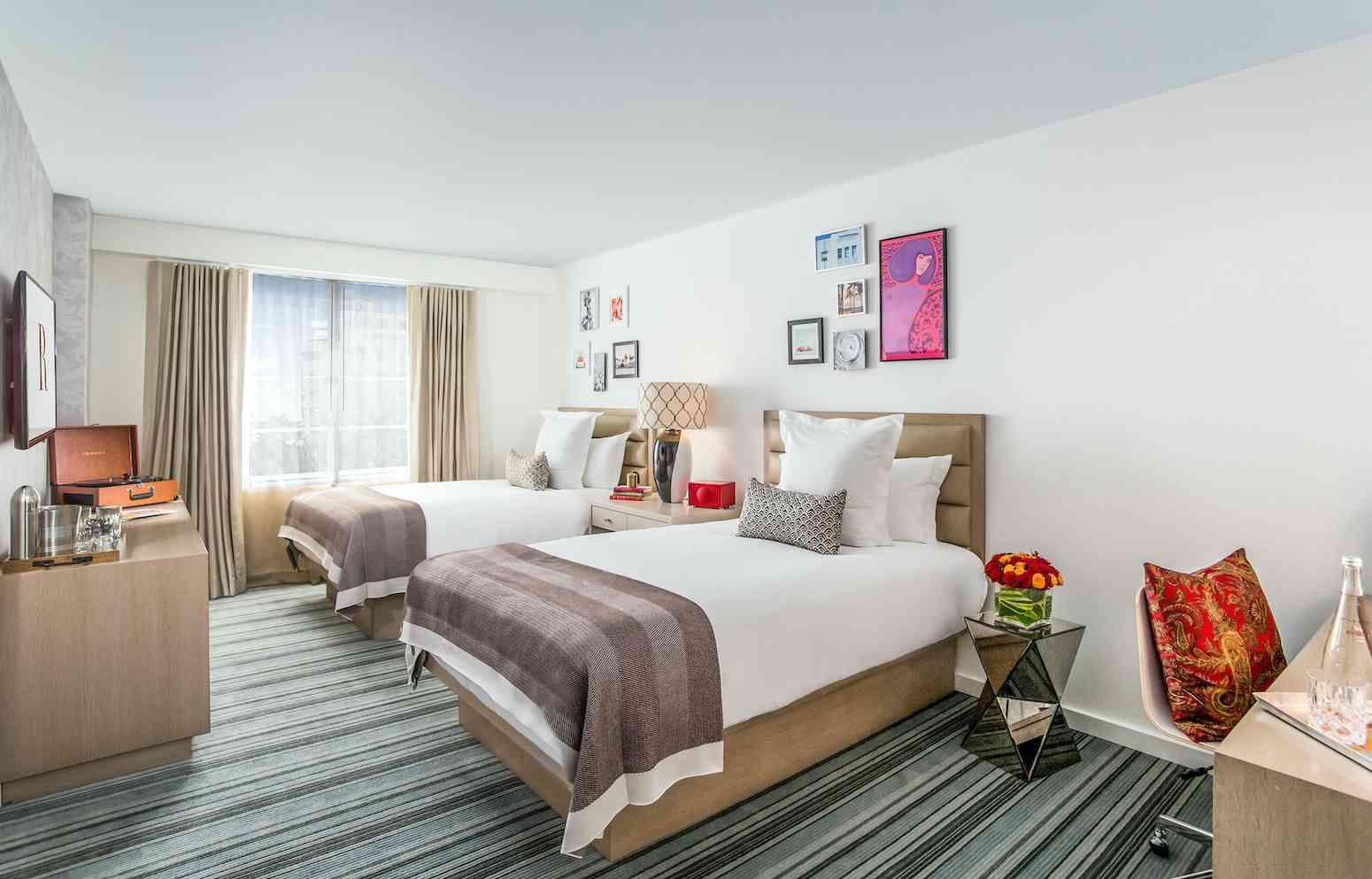 double beds in light room with beige accents