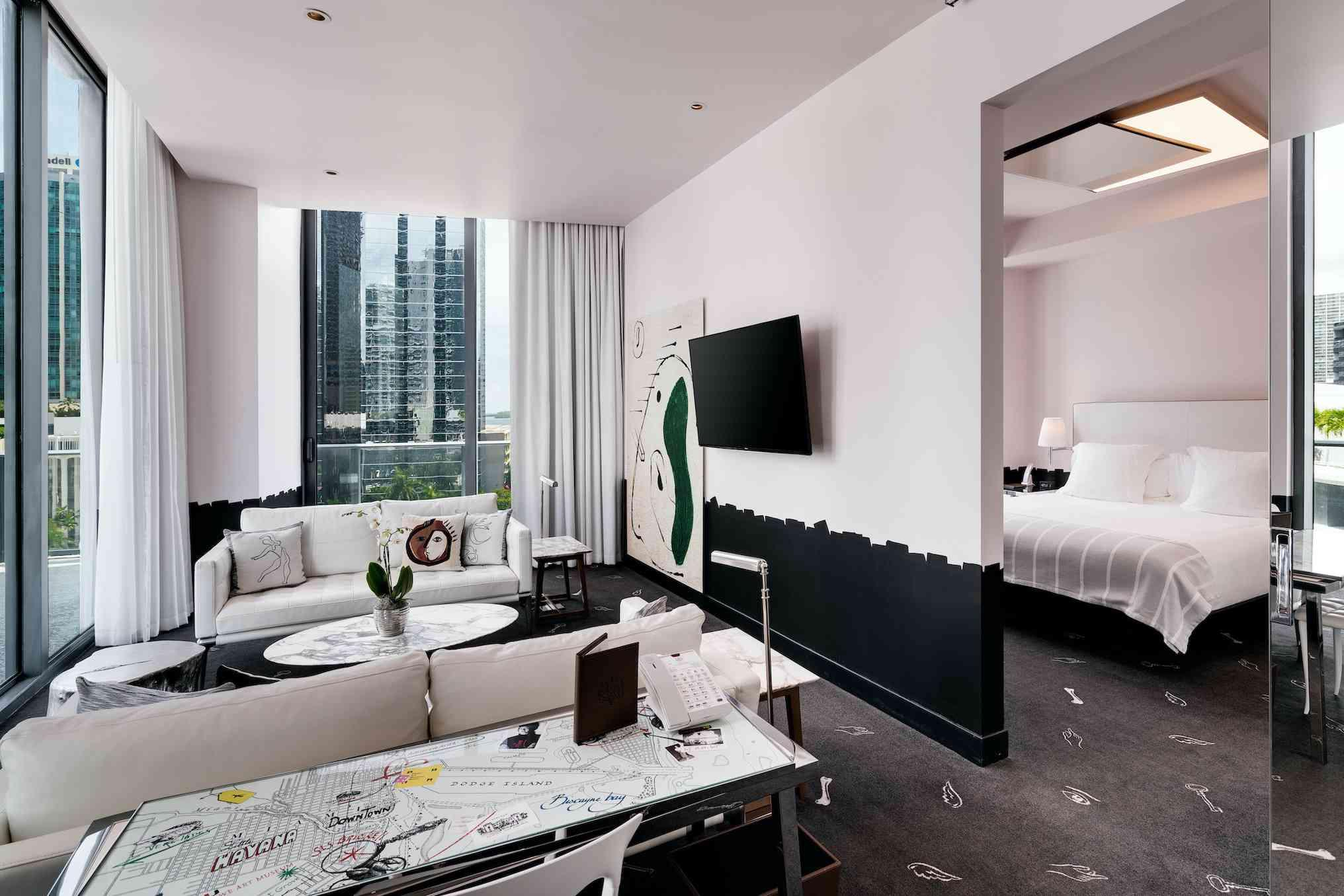 large living space with wall art and bedroom view