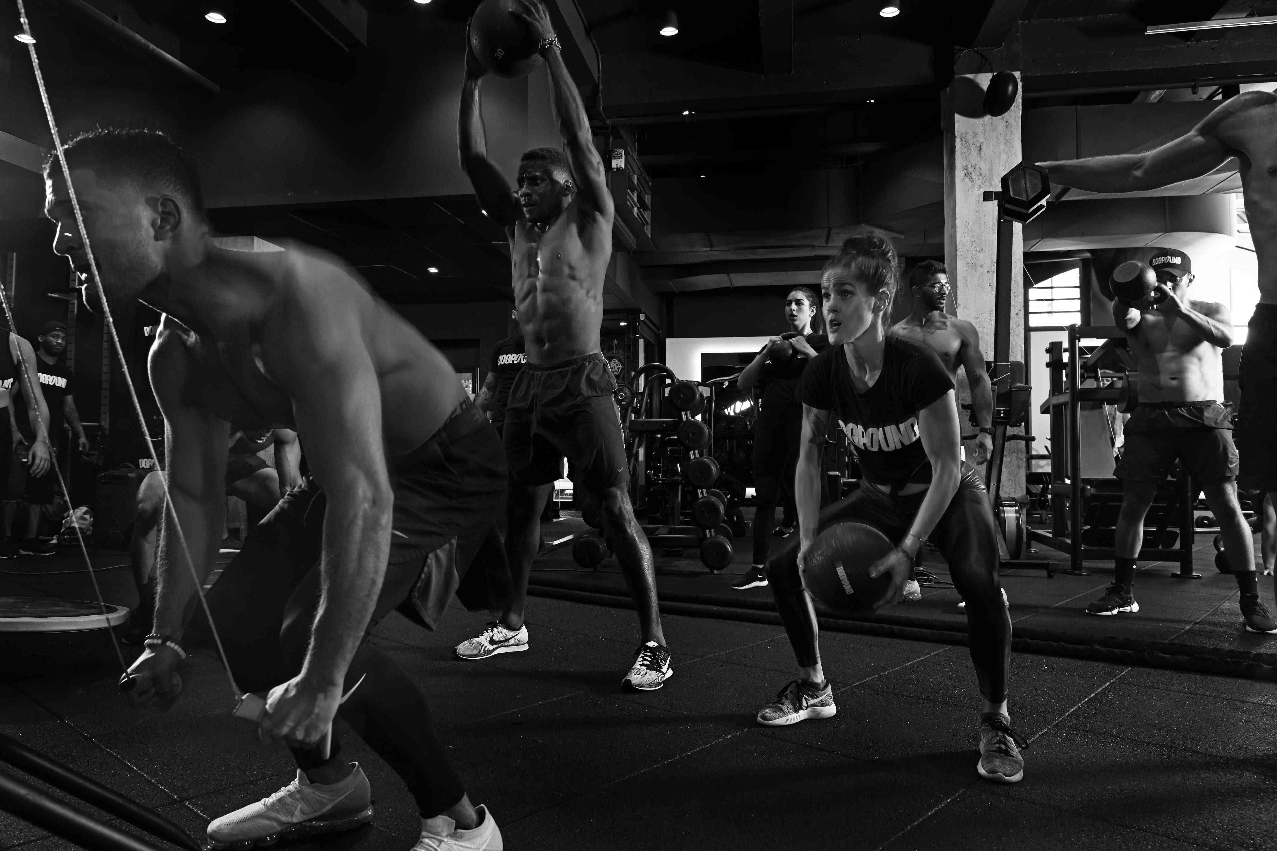 people working out in gym black and white