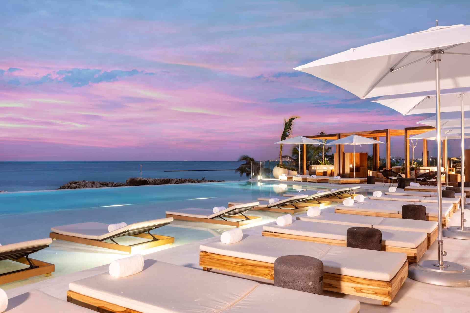 pool overlooking the ocean at dusk