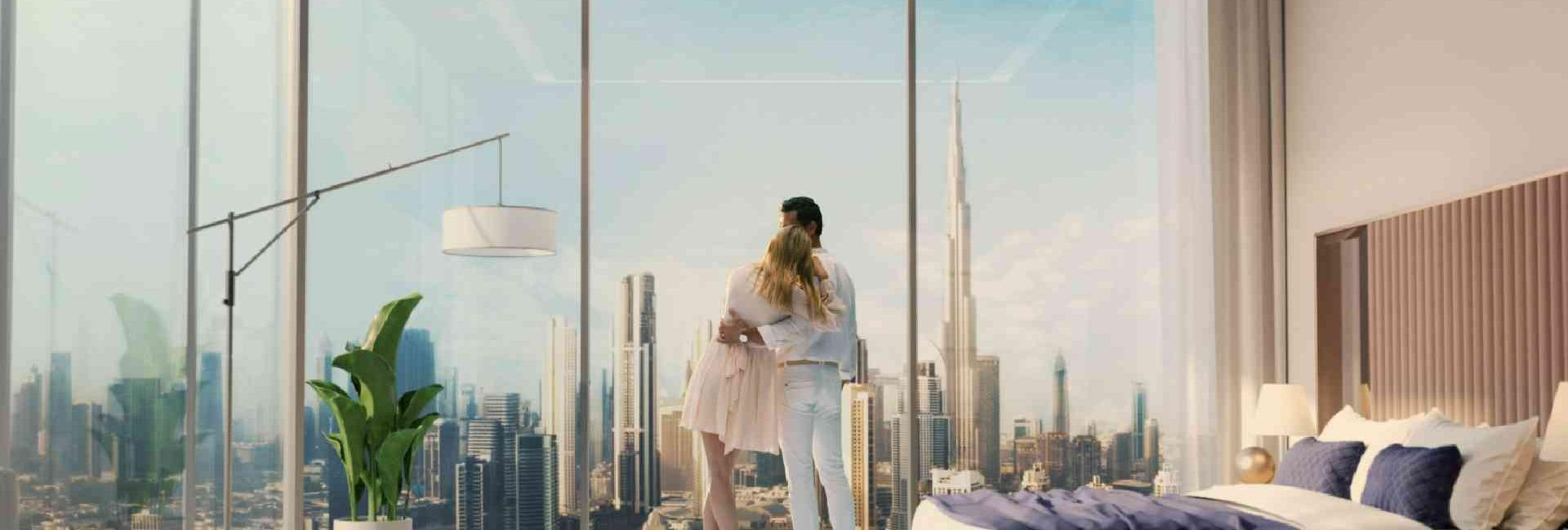 two people looking out of their room to the Dubai Skylive