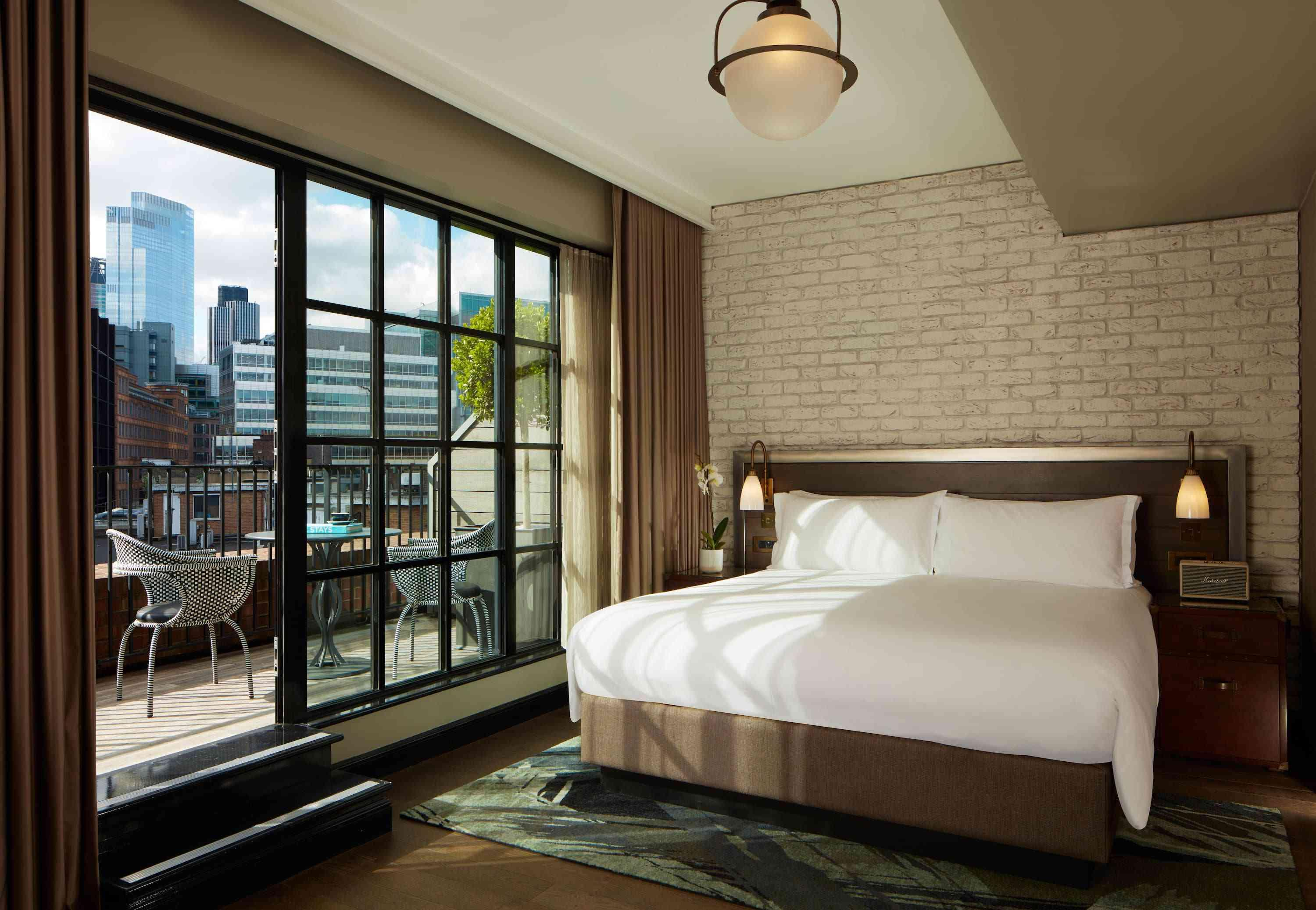 hotel room with a patio overlooking shoreditch