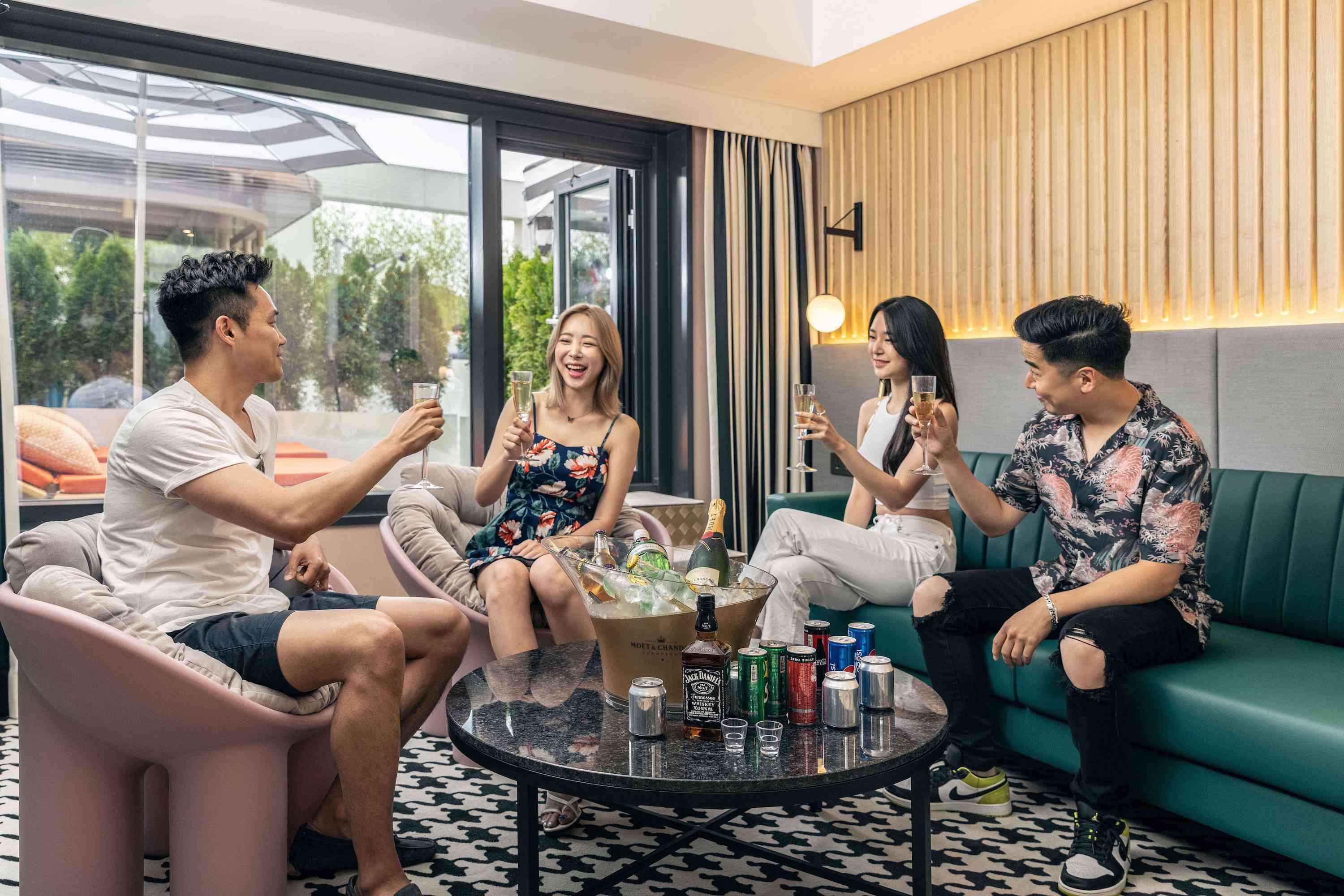 people with drinks in a lounge