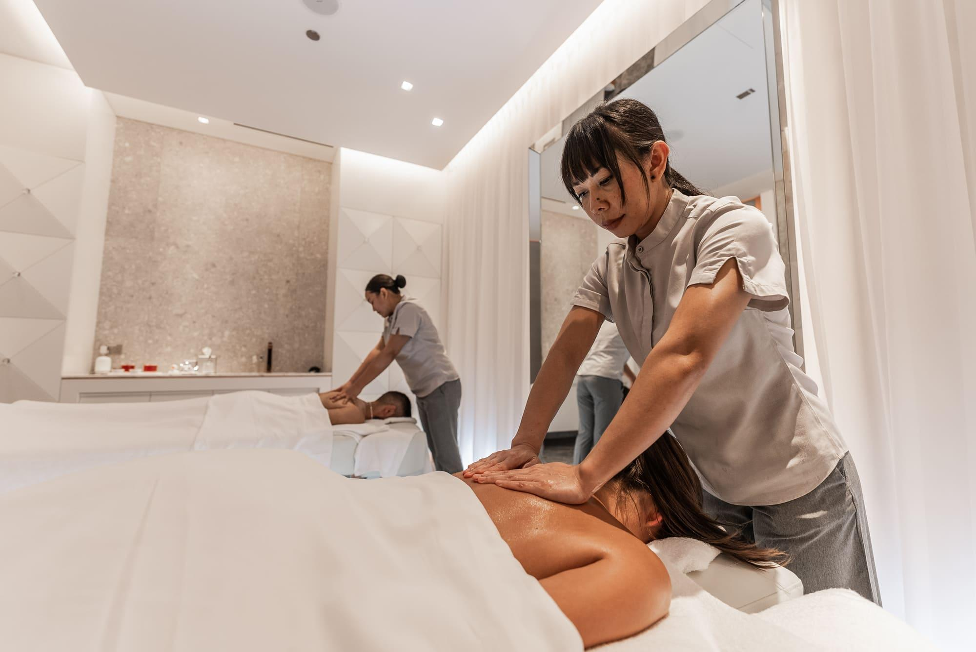 A couple getting a massage